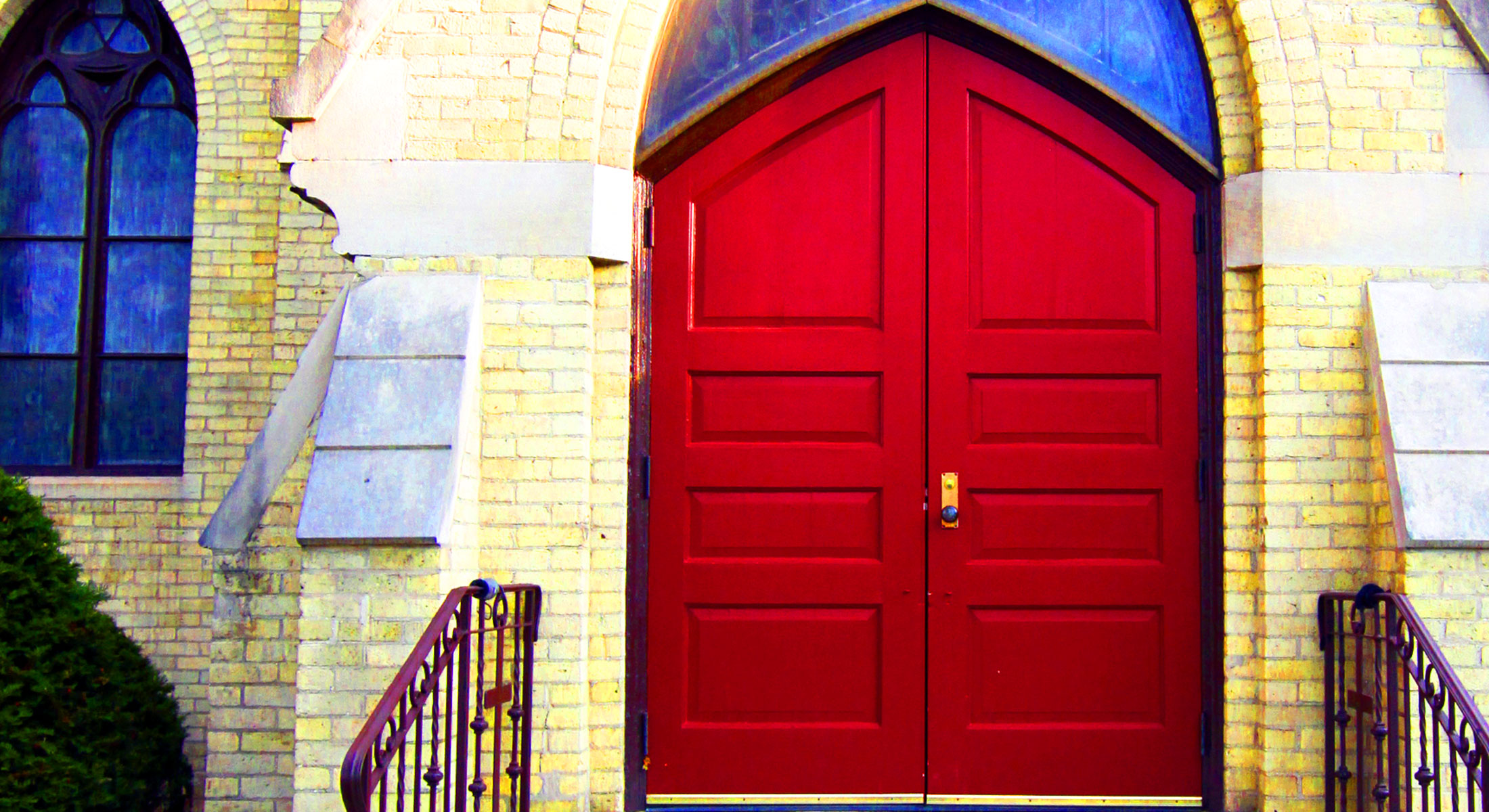 A picture of the front door of the church.