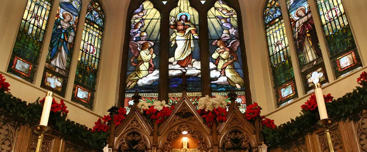 A picture of the stained glass windows above the altar.