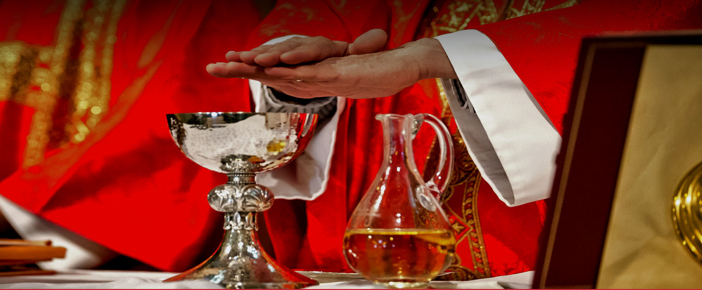 A picture of the Pastors hands over a goblet.